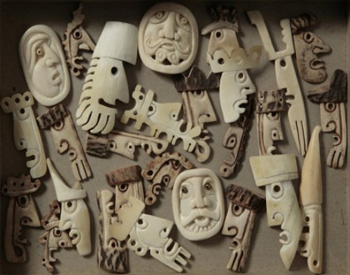 Collection of carved heads and faces - Details