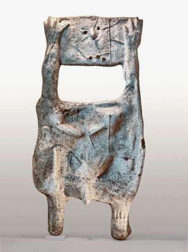Standing Figure Holding Head - Details