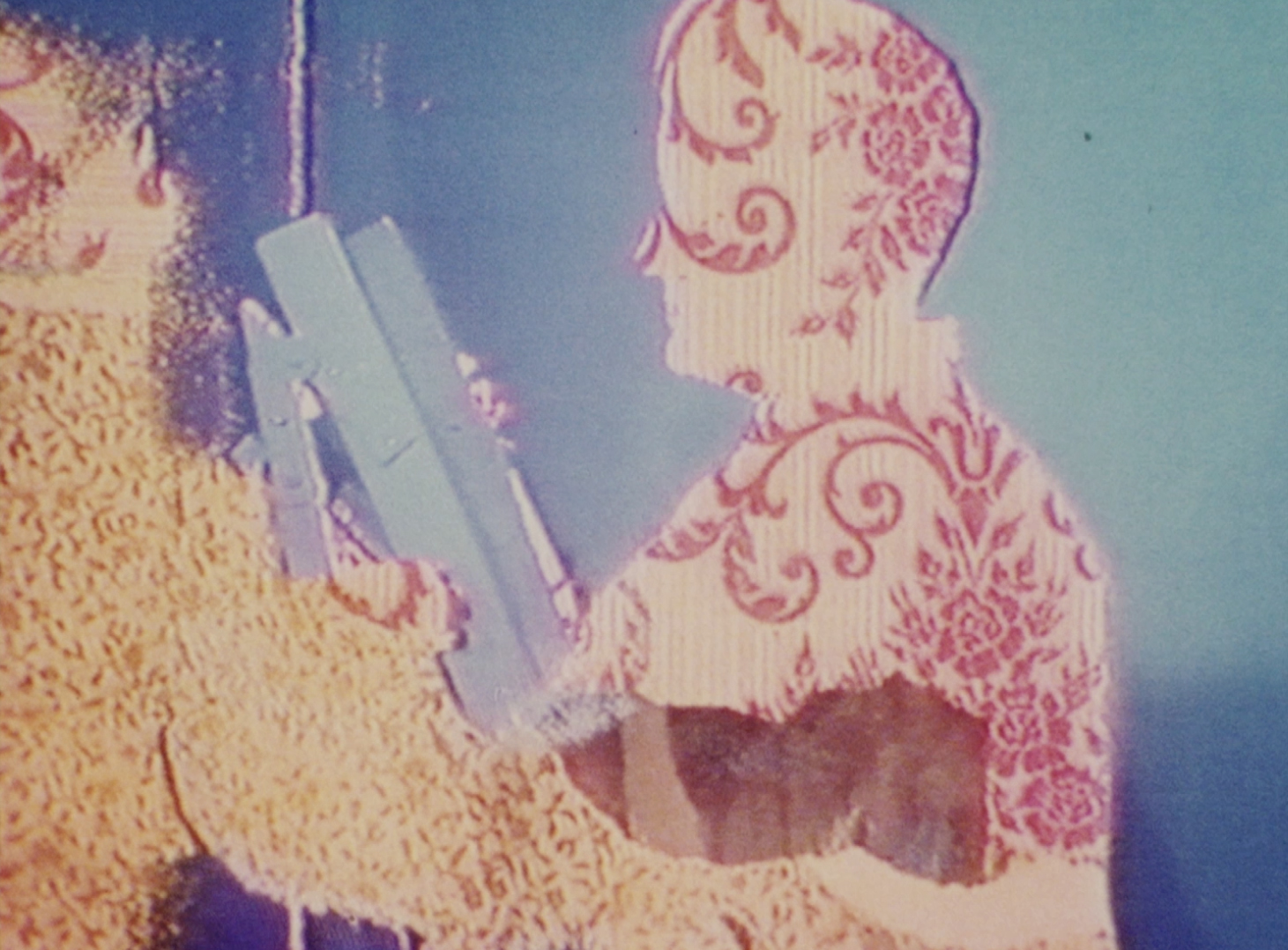 Film still from 'Faded Wallpaper' by Tina Keane