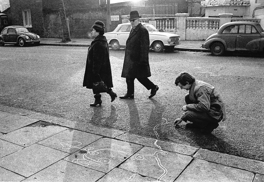 CLAY PERRY: Tjebbe van Tijen drawing on Kensington Park Road, Notting Hill (1966). Archival pigment print.